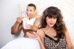 Mature Cougar with her Boyfriend in Bed Royalty Free Stock Image
