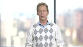 Mature coughing man, blurred background. stock video