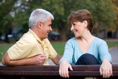 Mature couple. In love speaking at the park stock image