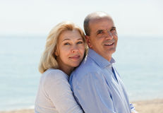 Mature couple against sea in background Royalty Free Stock Images