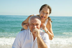 Mature couple against sea Stock Photo