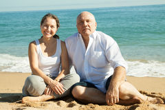 Mature couple against sea Royalty Free Stock Photo