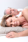 Mature couple asleep stock photo