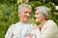 Mature couple in the autumn park Stock Image