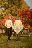 Mature couple in the autumn park Royalty Free Stock Photo