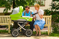 Mature couple with baby carriage Royalty Free Stock Photos