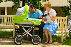 Mature couple with baby carriage Royalty Free Stock Image