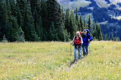 Mature Couple Backpacking Through Singing Pass Royalty Free Stock Photography