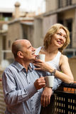 Mature couple on balcony with coffee Stock Photography