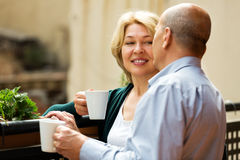 Mature couple on balcony with coffee Royalty Free Stock Photos