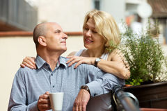 Mature couple on balcony with coffee Royalty Free Stock Photo
