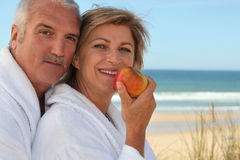 Mature couple in bathrobes Stock Images