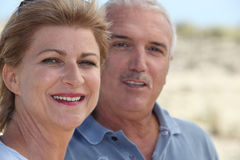 Mature couple at the beach Stock Photography