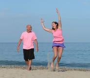 Mature couple on beach Stock Photos