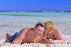 Mature couple on the beach in the tropics. Royalty Free Stock Image
