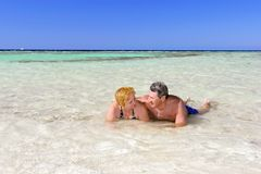 Mature couple on the beach in the tropics. Royalty Free Stock Photos