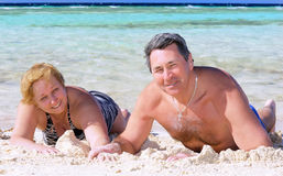 Mature couple on the beach in the tropics. Stock Photography