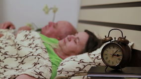 Mature couple in bed sleeping stock video
