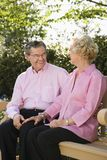 Mature couple on bench. stock photo