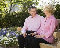 Mature couple on bench. Royalty Free Stock Photography