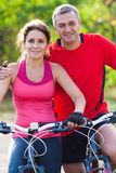 Mature couple on  bicycle Royalty Free Stock Image