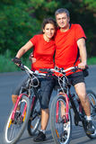 Mature couple on  bicycle Stock Images