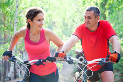 Mature couple on  bicycle Stock Photos