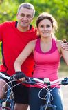 Mature couple on  bicycle Royalty Free Stock Photos