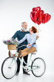 Mature couple with bicycle Stock Photo