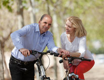 Mature couple with bicycles Royalty Free Stock Photography