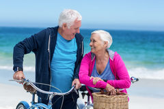 Mature couple with bicycles Stock Photos