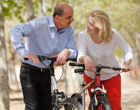 Mature couple with bicycles Royalty Free Stock Photo