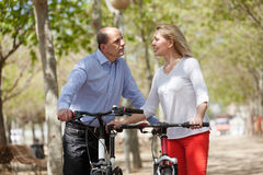 Mature couple with bicycles Royalty Free Stock Image