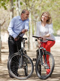 Mature couple with bicycles Royalty Free Stock Photos