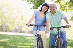 Mature couple bike riding Stock Photo