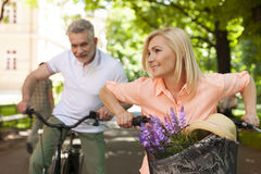 Mature couple on bikes outdoors Stock Image