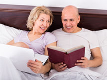 Mature couple burring with laptop Royalty Free Stock Images