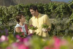 Mature Couple Buying Flower Plants Royalty Free Stock Photography
