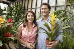 Mature Couple Buying Potted Plant Royalty Free Stock Photography