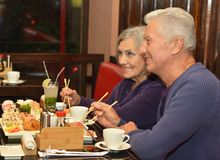 Mature couple in cafe Royalty Free Stock Photo