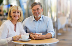 Mature couple at cafe Stock Images