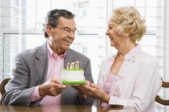 Mature couple with cake. royalty free stock photography