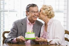 Mature couple with cake. Royalty Free Stock Image