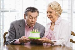 Mature couple with cake. royalty free stock images