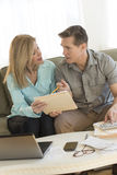 Mature Couple Calculating Home Finances On Sofa Royalty Free Stock Photography