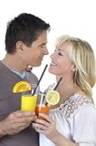 Mature couple celebrating with cocktails Royalty Free Stock Images