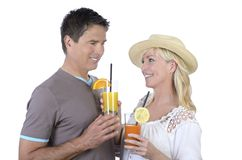 Mature couple celebrating with cocktails Stock Photos