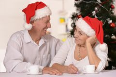 Mature couple celebrating new year Stock Photos