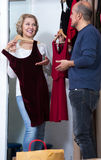 Mature couple choosing apparel in store. Portrait of mature couple choosing new apparel in store Stock Photos