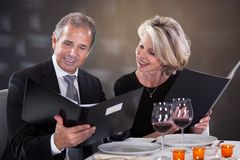 Mature couple  choosing menu Royalty Free Stock Photo